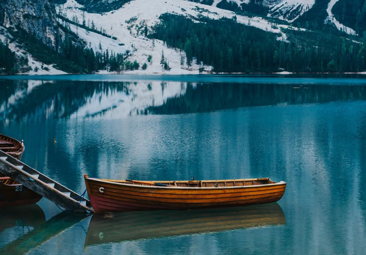 On a lake in the Rocky Mountains of Colorado, a single wooden canoe offers protection fron the cold, winter waters below.